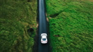 istock Aerial view electric car driving on country road 541931266