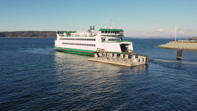 Aerial View Elevating Up Over Departing Puget Sound Ferry