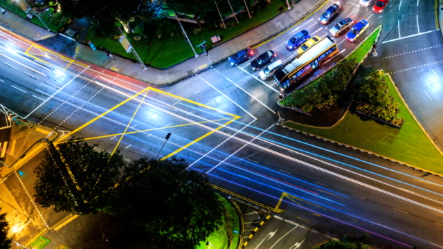 Aerial View Fast Speed Crossroad Traffic On Night Time 4K Time Lapse (zoom out) video