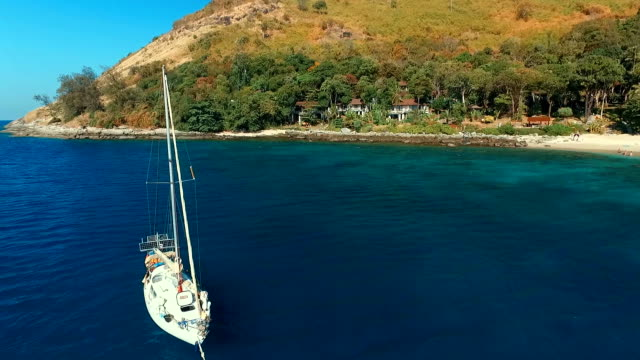 Aerial view: Flying around the yacht near the beach. video