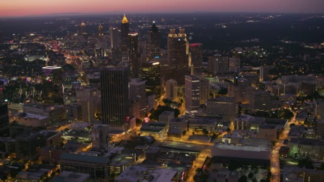 Aerial view flying over downtown Atlanta at dusk. video