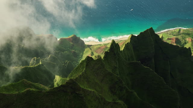Aerial view flying over jungle mountain peaks, Na Pali coast Kauai
