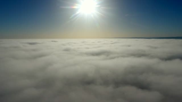 vídeos de stock e filmes b-roll de aerial view, flying through clouds at sunset - transatlântico