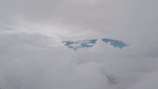 Aerial view footage. Airplane flying through the clouds. Pilot's view Airplane flying through the clouds at high altitudes above the clouds. Pilot's eye view cockpit stock videos & royalty-free footage