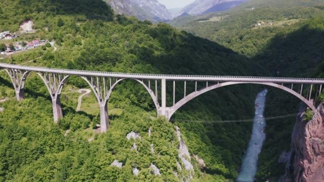 Aerial view footage of Durdevica Tara arc bridge in the mountains of Montenegro