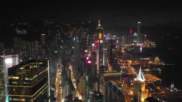 4k flygfoto bilder av hong kong city efter solnedgången - rådig bildbanksvideor och videomaterial från bakom kulisserna