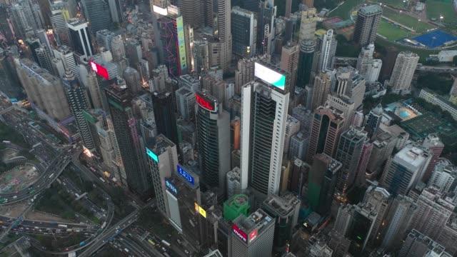 4k flygfoto bilder av hong kong city i solnedgång - rådig bildbanksvideor och videomaterial från bakom kulisserna