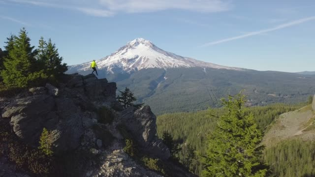 Aerial view, forest and volcano during beautiful sunny day. Mount Hood is active stratovolcano in the Cascade Volcanic Arc. Pacific Northwest region of the United States. Oregon, USA Background nature