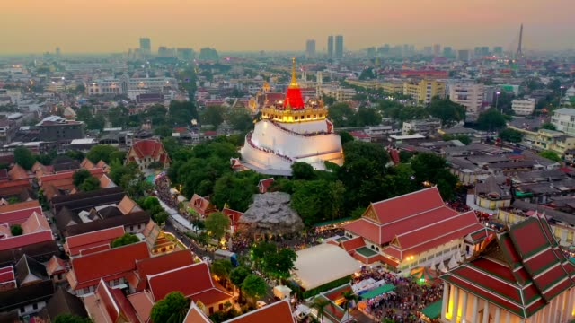 aerial view from a drone of wat saket(phukhao thong) in bangkok - temple of the golden mountain - wat video stock e b–roll