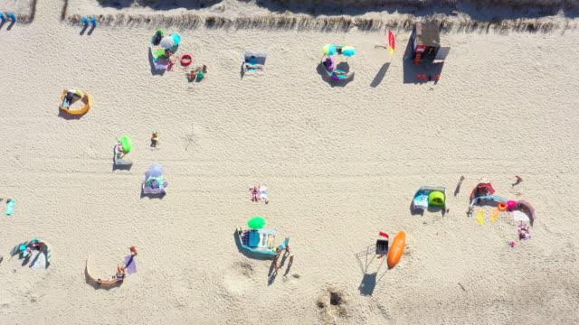Aerial view from above Baltic Sea coast beach Hel aerial drone top view. People sunbathing.