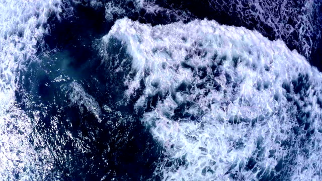 Aerial view from above on a raging ocean. Aerial view video