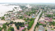 istock Aerial View from above on the flooded houses and the city. Flood after floods from the mountains. The houses are flooded with dirty water of the flooded river 1254942934