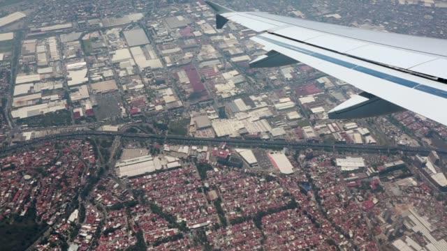 Aerial view from airplane as it starts to land over Mexico City. video