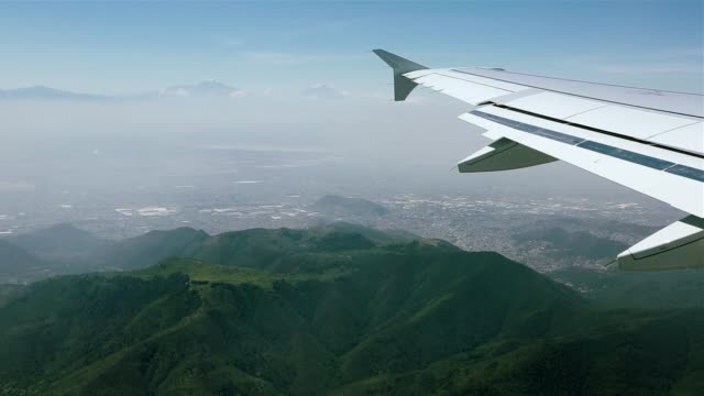 Aerial view from an airplane over mountains in Mexico City video