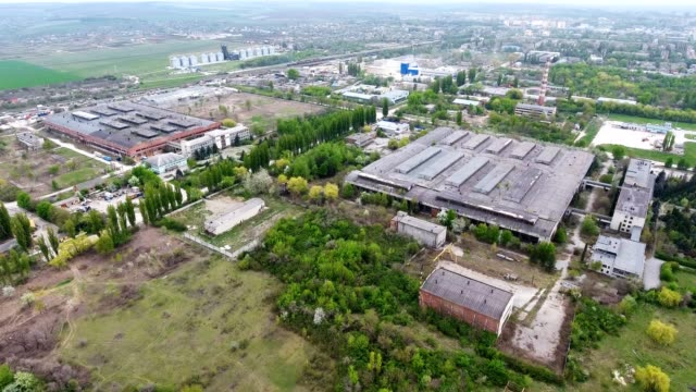 Aerial view from the air to an abandoned factory. Abandoned building exterior.