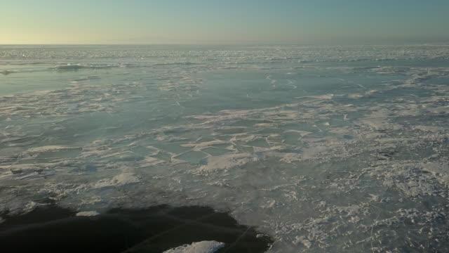 vídeos de stock e filmes b-roll de aerial view from the air. winter. ice lake baikal russia - lago baikal