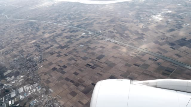 aerial view from the airplane showing rural area view