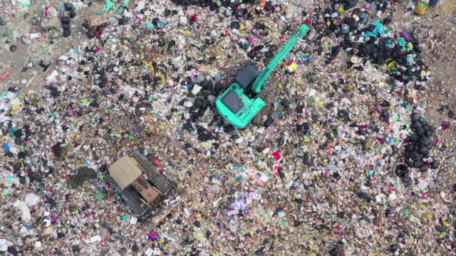 Aerial view Garbage truck moves trash in a landfield