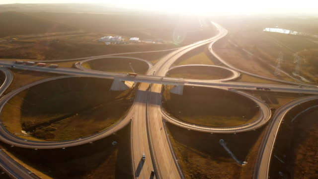 Aerial view. Highway and overpass with cars and trucks