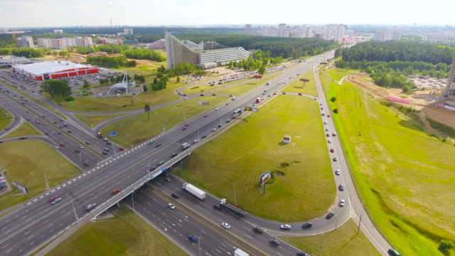 Aerial view highway, freeway, urban city transportation. Rush Hour. Cars Passing video
