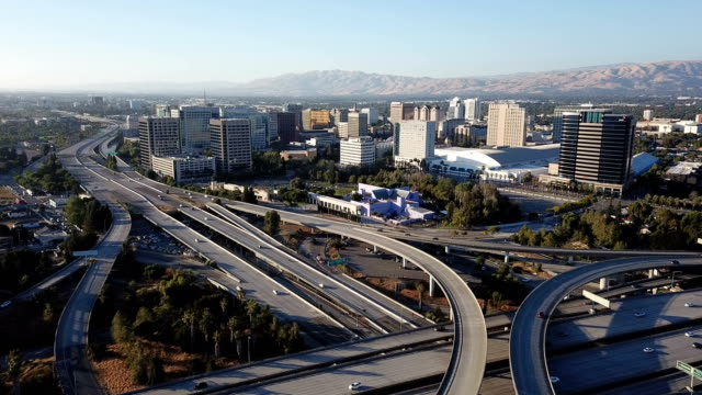 Aerial View Highway Interchange Infrastructure Over San Jose California Cars travel around and around on July 4th, 2018 over the city of San Jose california stock videos & royalty-free footage