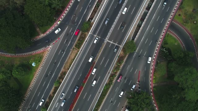 aerial view highway road with circling drone angle sudirman jakarta