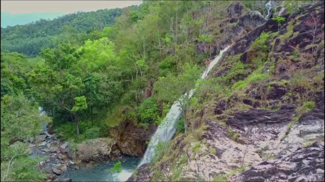 aerial view hilly landscape with waterfall lake and jungles - quadcopter filmów i materiałów b-roll