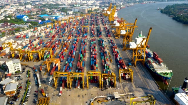 vídeos de stock e filmes b-roll de aerial view hyper-lapse or time-lapse of industrial port with containers ship - docas