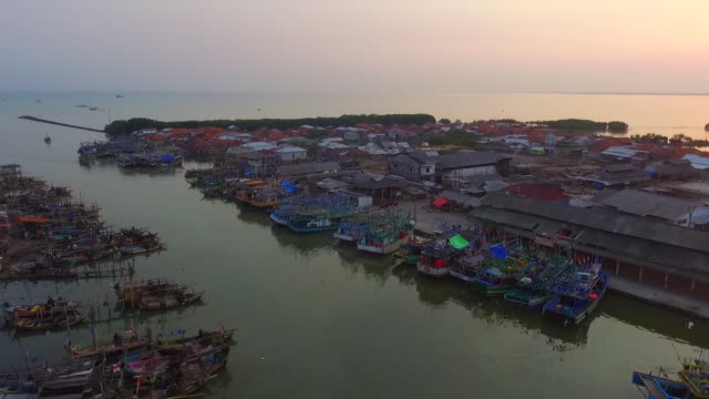 aerial view in a fishing village with hundreds of fishing boats parked. This scene was taken on the coast of Eretan Wetan Village, Kandanghaur District, Indramayu Regency