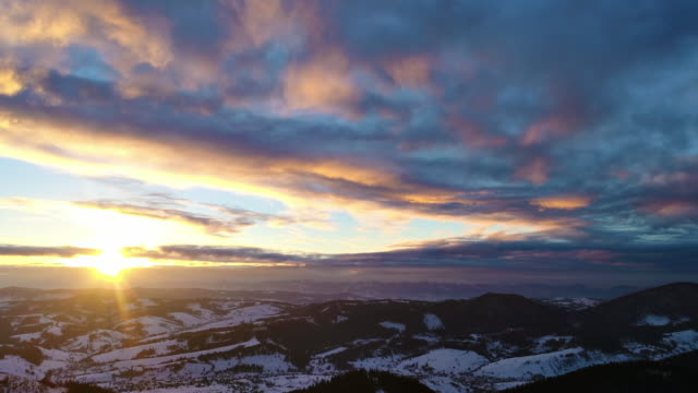 Aerial view in sundown winter mountain