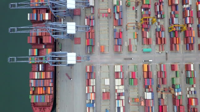 aerial view, industrial port with containers ship - nave mercantile video stock e b–roll