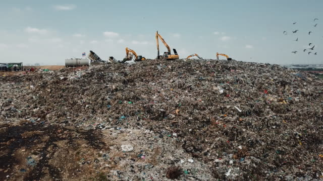 Aerial view landfill with garbage trucks unloading junk Garbage ,Aerial view,Garbage, Landfill, Garbage Dump, Pollution indonesia stock videos & royalty-free footage