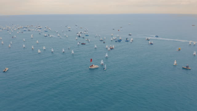 Aerial view. Large group of small Sail boats at sea Aerial view. Large group of small Sail boats at sea yachting stock videos & royalty-free footage