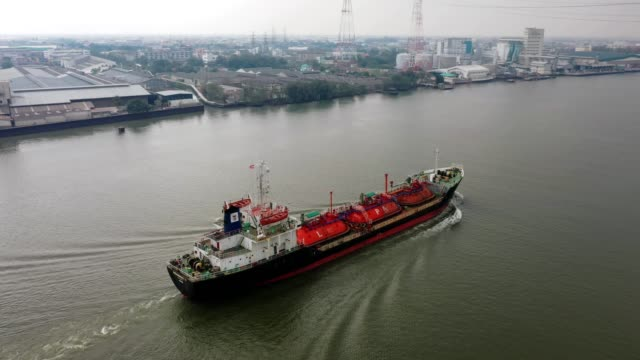 Aerial view Liquefied Petroleum Gas (LPG) tanker, Tanker ship logistic and transportation business oil and gas industry on river