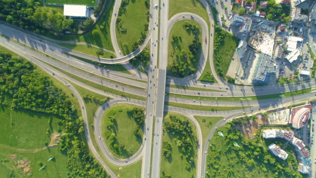 vídeos de stock e filmes b-roll de aerial view looking down eagle eye shot of highway road in sofia, bulgaria in time lapse - green city