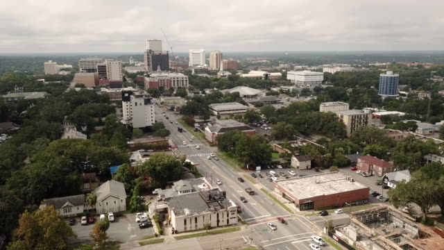 Aerial View Looking up Apalachee Parkway all the way to the Capital Building in Tallahassee Traffic on the main street of Apalachee Pkwy in the downtown urban core of the Florida State Capitol in Tallahassee florida us state stock videos & royalty-free footage