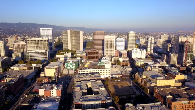 Aerial View Looking West into the Downtown City Skyline of Oakland Califonia A slow slide right in an aerial view of the buildings architecture of Oakland CA oakland stock videos & royalty-free footage