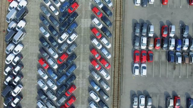 aerial view lot of vehicles on parking for new car. video - caravan stock videos & royalty-free footage