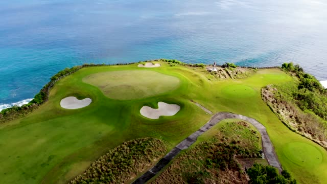 Aerial view luxury golf field next the cliff. Bali, Indonesia