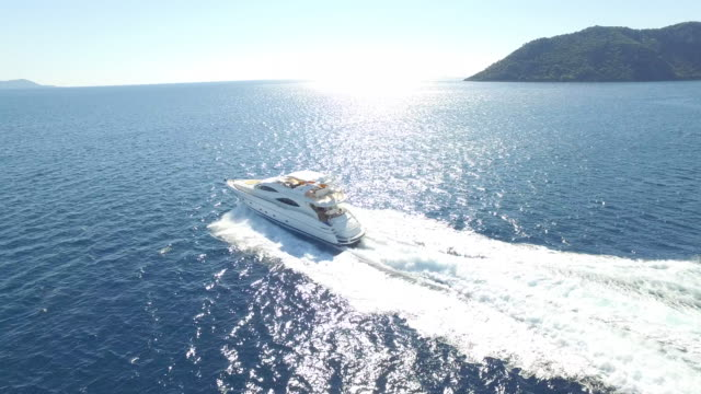 Aerial view luxury yacht on sea Aerial view of the sailing yachts on the sea in Bodrum, Turkey yacht stock videos & royalty-free footage