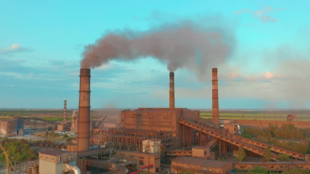Aerial view. Metallurgical plant. Smoke coming out of factory pipes Aerial view. Metallurgical plant. Smoke coming out of factory pipes metallurgy stock videos & royalty-free footage
