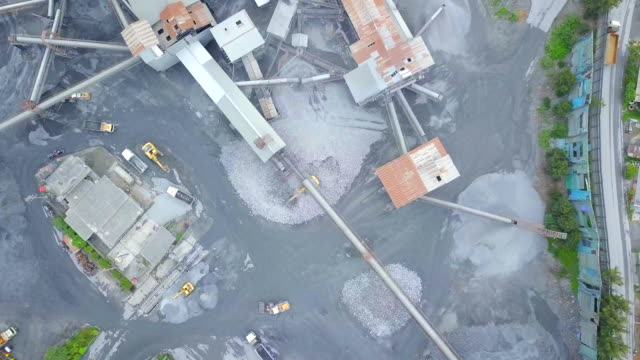 Aerial view Mine and heavy equipment limestone crusher and truck and backhoe video