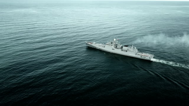 Bидео Aerial View - modern warship on the high seas
