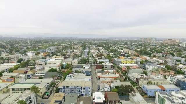 Aerial view moving away from neighborhood towards the ocean in California video