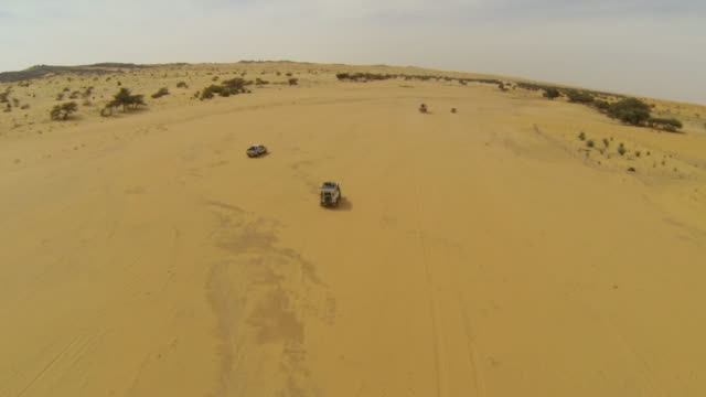 Aerial (drone) view of 4x4 truck driving through remote terrain  durability stock videos & royalty-free footage