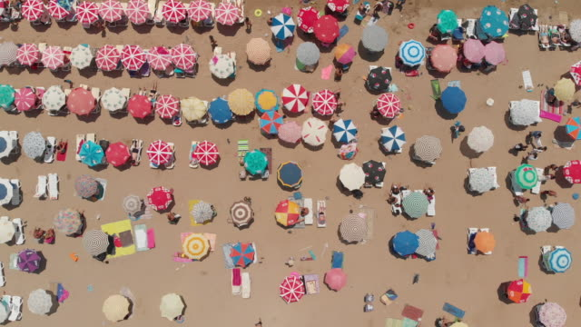 Aerial View of a Beach With Crowd Enjoying Sea Didim, Aydin, Turkey lounge chair stock videos & royalty-free footage