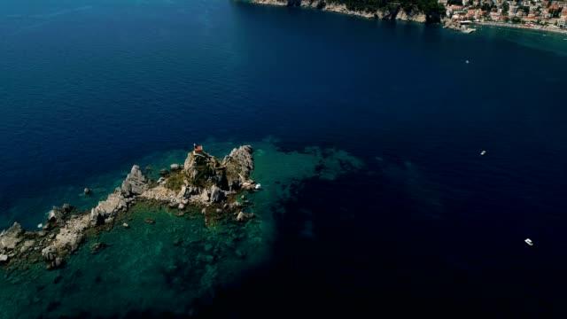 aerial view of a beautiful island with church in the adriatic sea - viaggio d'istruzione video stock e b–roll