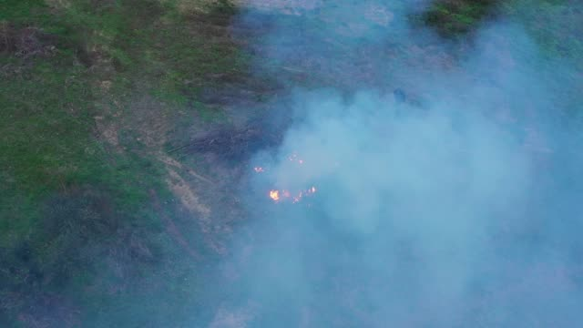 Aerial view of a bonfire lit in a countryside area. Aerial view of a bonfire lit in a countryside area. expressionism stock videos & royalty-free footage