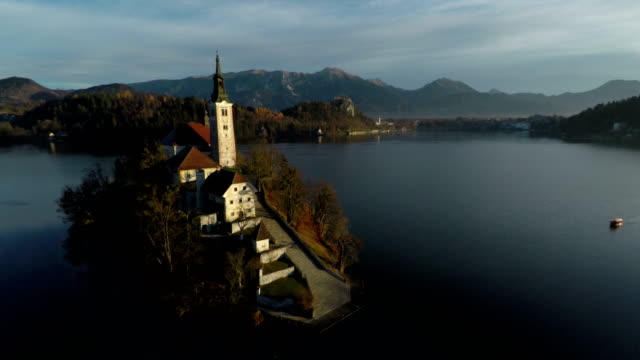 aerial view of a church on an island - ferragosto video stock e b–roll