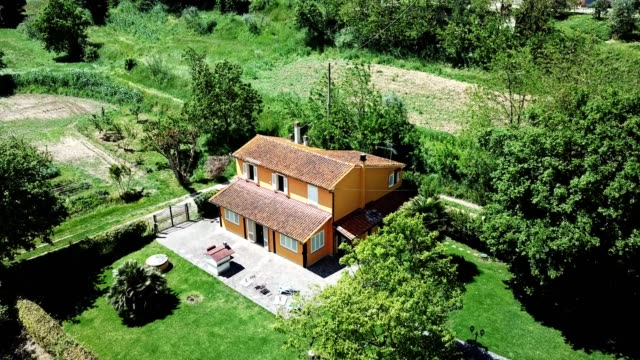 aerial view of a countryside home in the tuscany hills